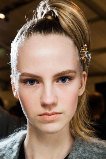Use a precious brooch to fix your hair. In this case, make-up needs to be really soft and natural. (Prada, FW 2015)