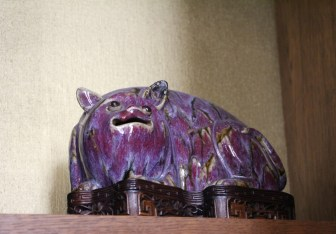 Tried to figure out what this creature was, and was told that it's supposed to be a dog. A weird purple dog.
