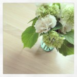 Sunday Bouquet: White Roses and Hydrangeas on Oak