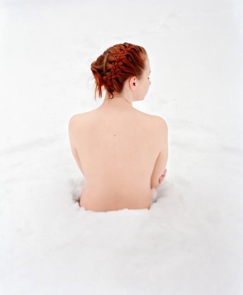 Nude Woman Sitting In Snow