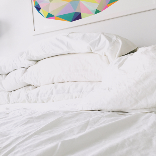 Empty Bed With White Sheets