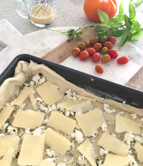 Adding Cheese To Puff Pastry For Tomato Tart