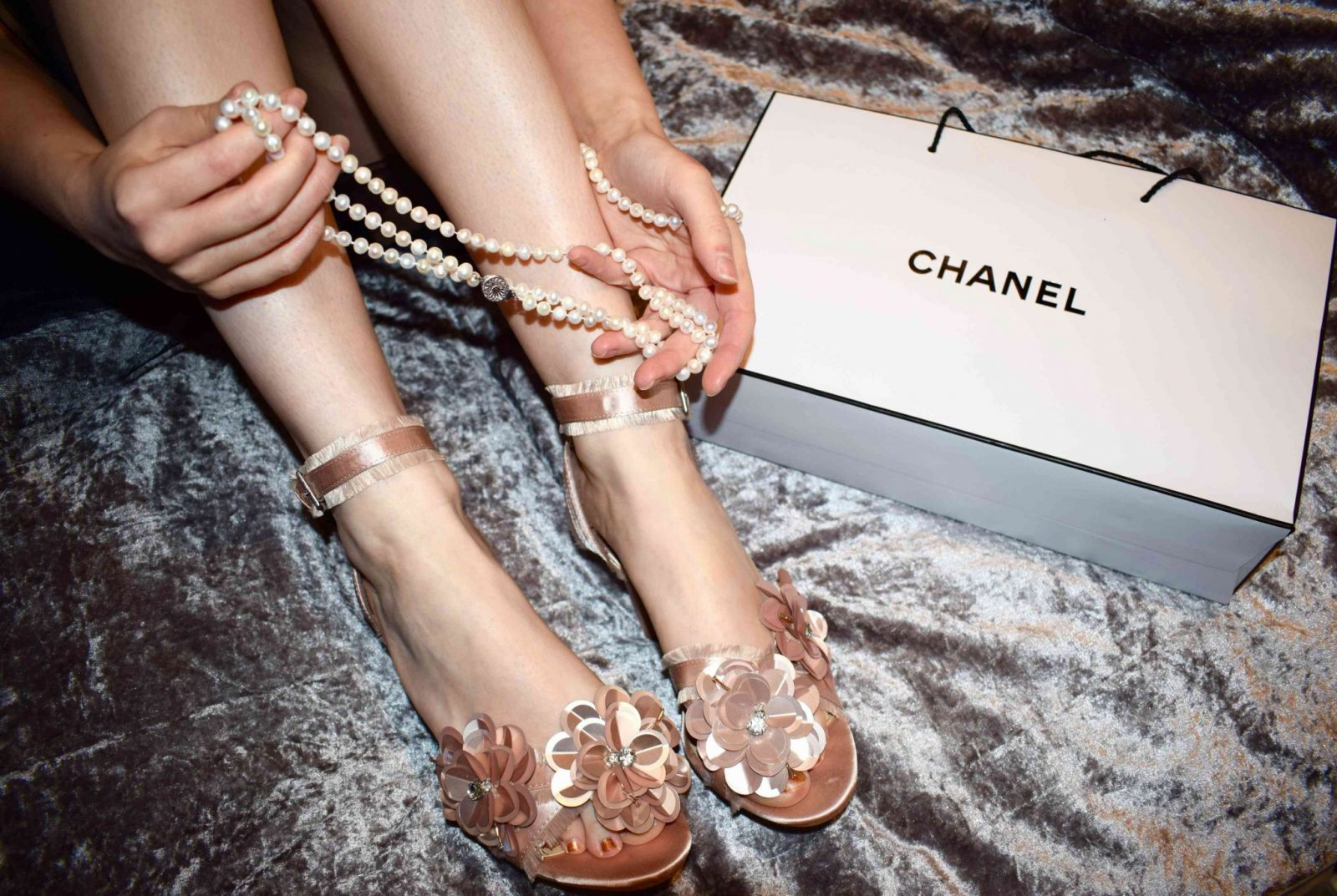 Blogger Twenty-Something City with Chanel bag, pearls, and floral sandals