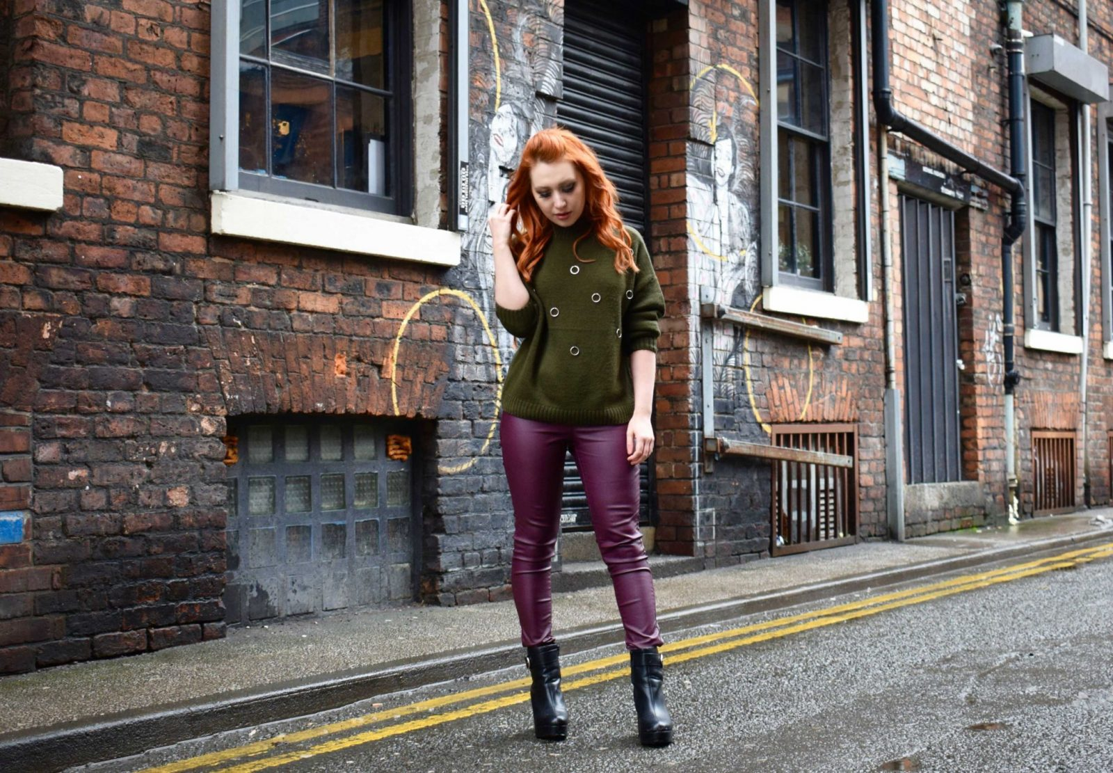 Blogger Twenty-Something City wearing cosy jumper and burgundy leather trousers in Northern Quarter Manchester