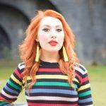 Blogger Twenty-Something City in bright rainbow stripe dress does social media make us unhappy
