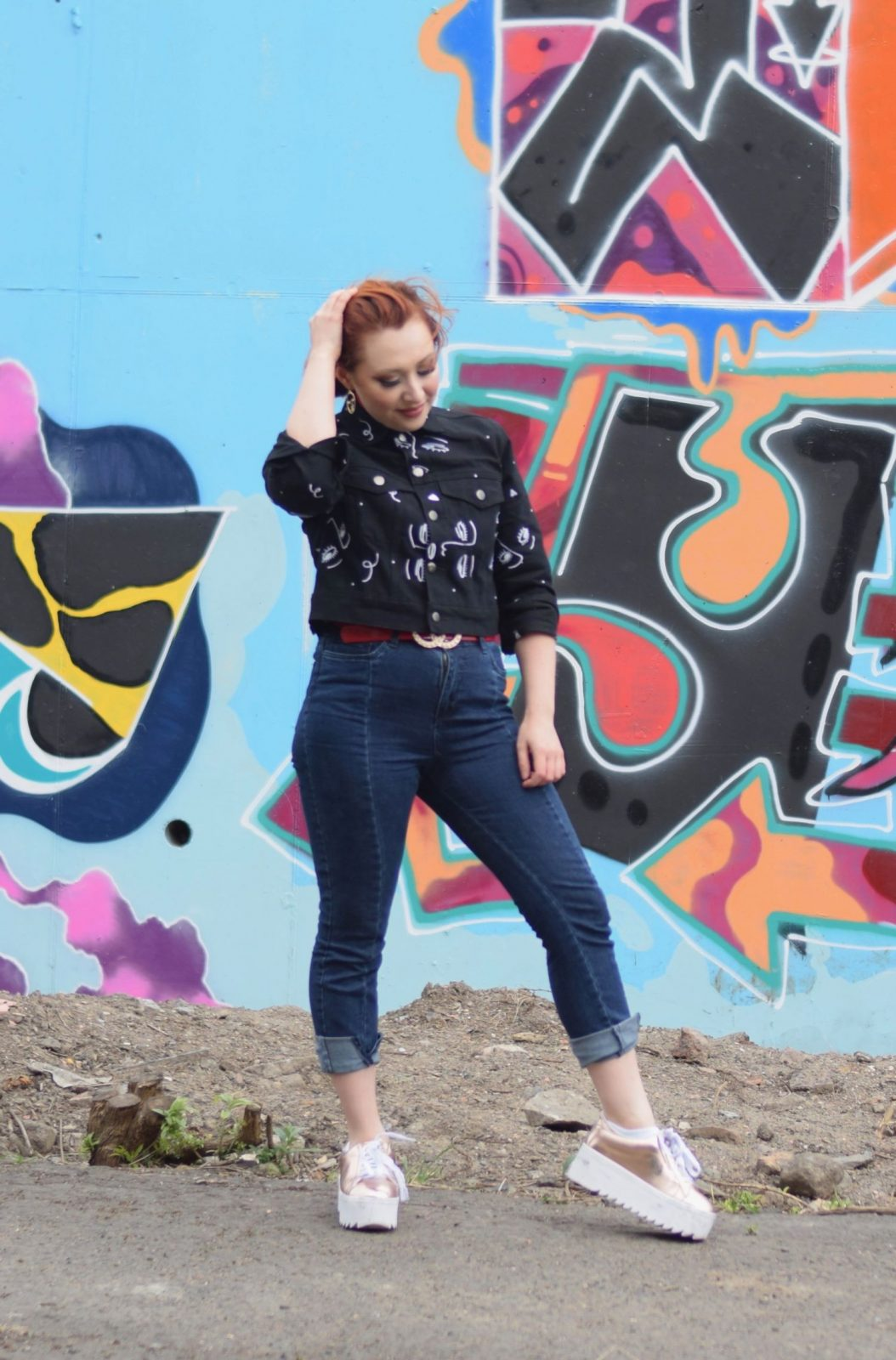 Blogger Twenty-Something City wears jeans, platform trainers and printed denim jacket