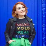 Scottish blogger Twenty-Something City wearing Shein sequin slogan 'Make your dreams happen' t-shirt on blue backdrop