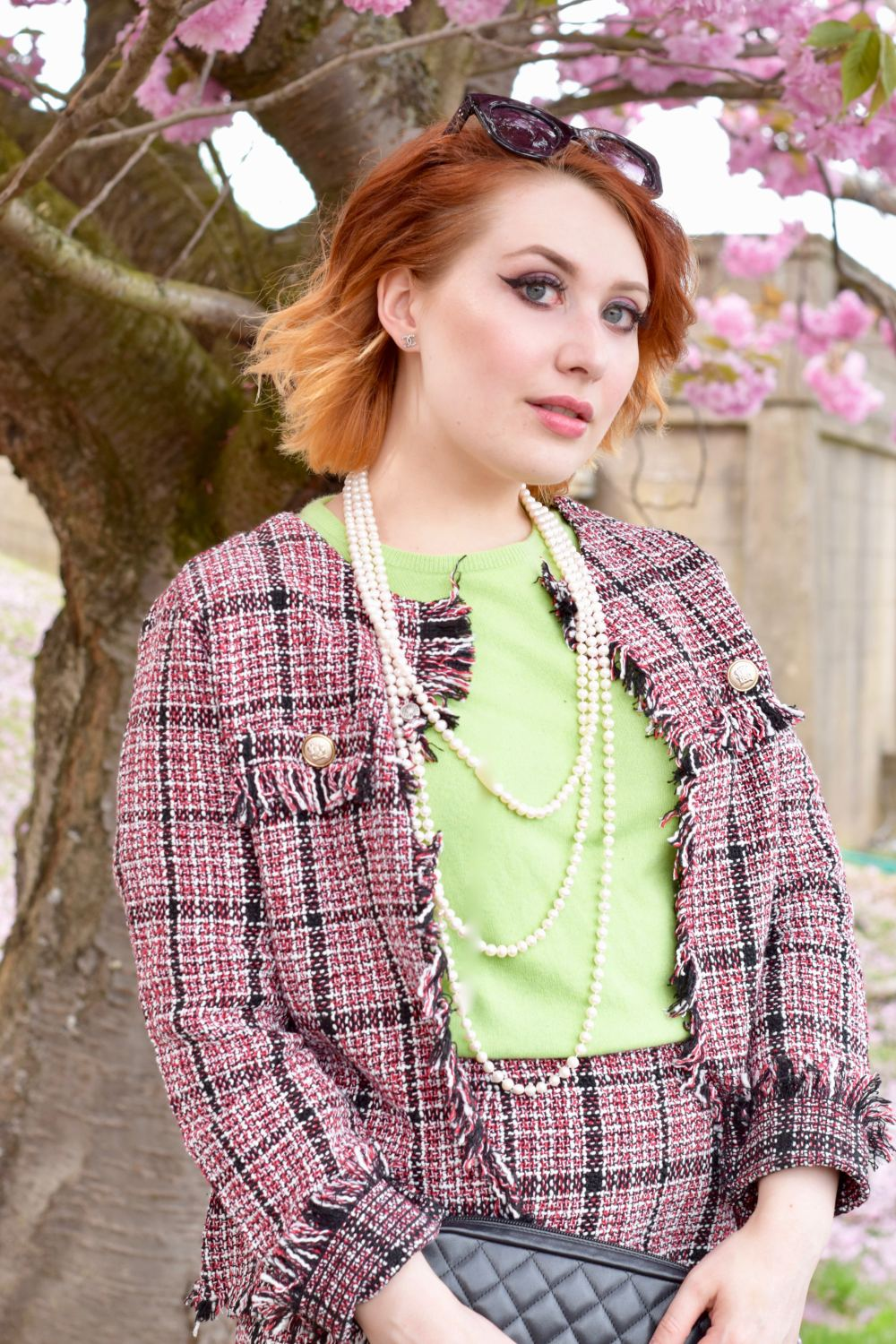 Scottish blogger Styled by Alice wears pink boucle tweed co ord and green cashmere jumper in the style of Chanel