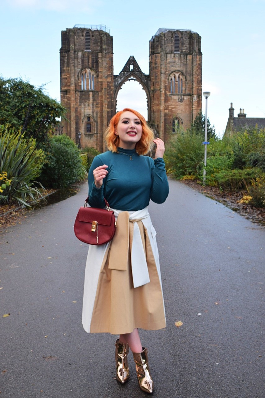 Alice wears tencel blouse and cotton wrap skirt, both from sustainable British brands