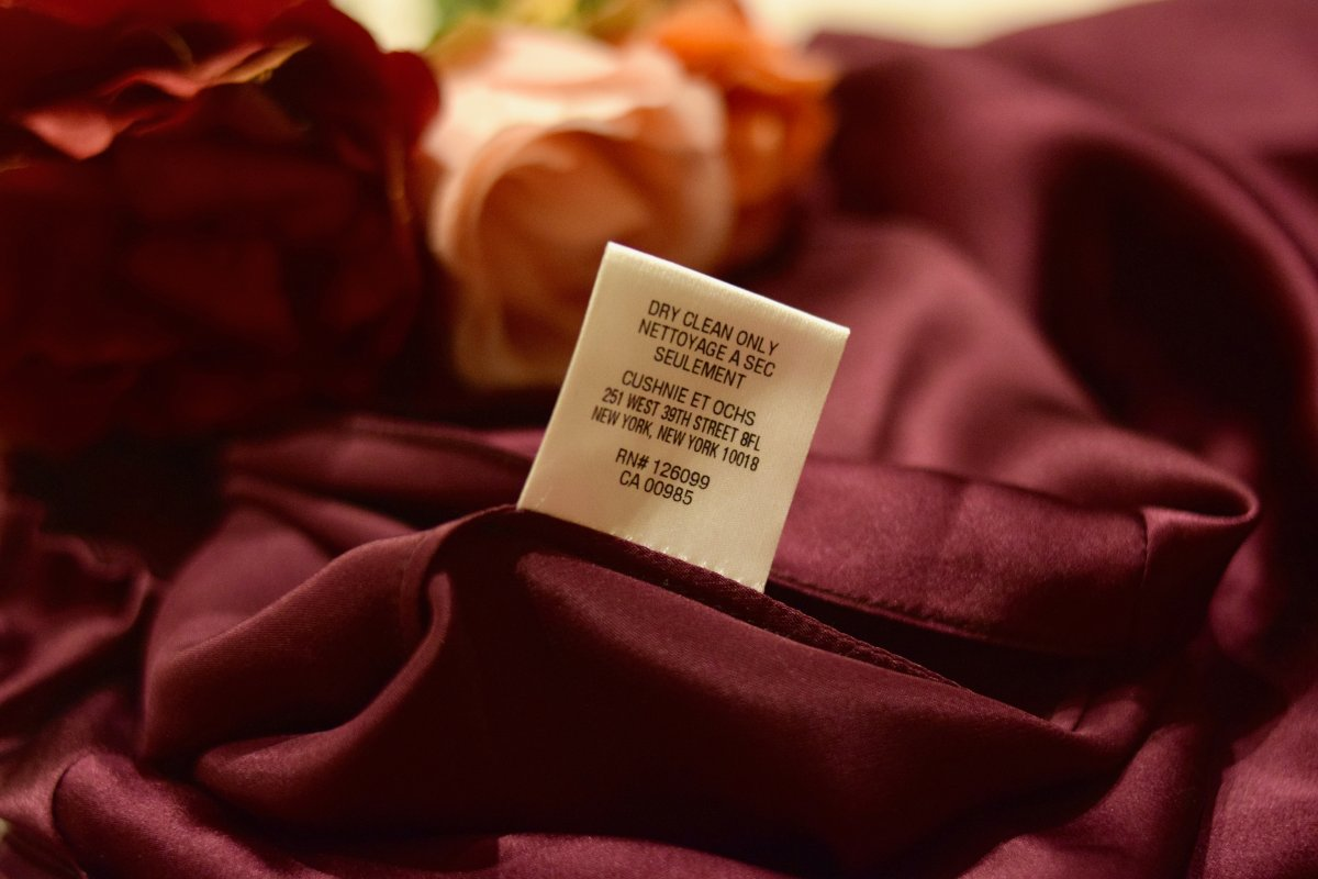 delicate burgundy silk top with dry clean only label