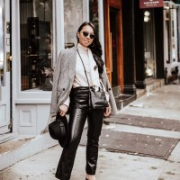 Elevated Business Casual: Tie-Neck Top, Faux Leather Trousers, Houndstooth Double-Breasted Blazer, Vinyl Shoe with Capped Toe, Black Felt Fedora, Prada Top Handle Mini Satchel and MVMT Accessories