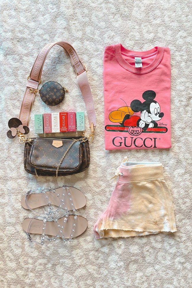 pink gucci tee with tie dye shorts and louis vuitton multi pochette