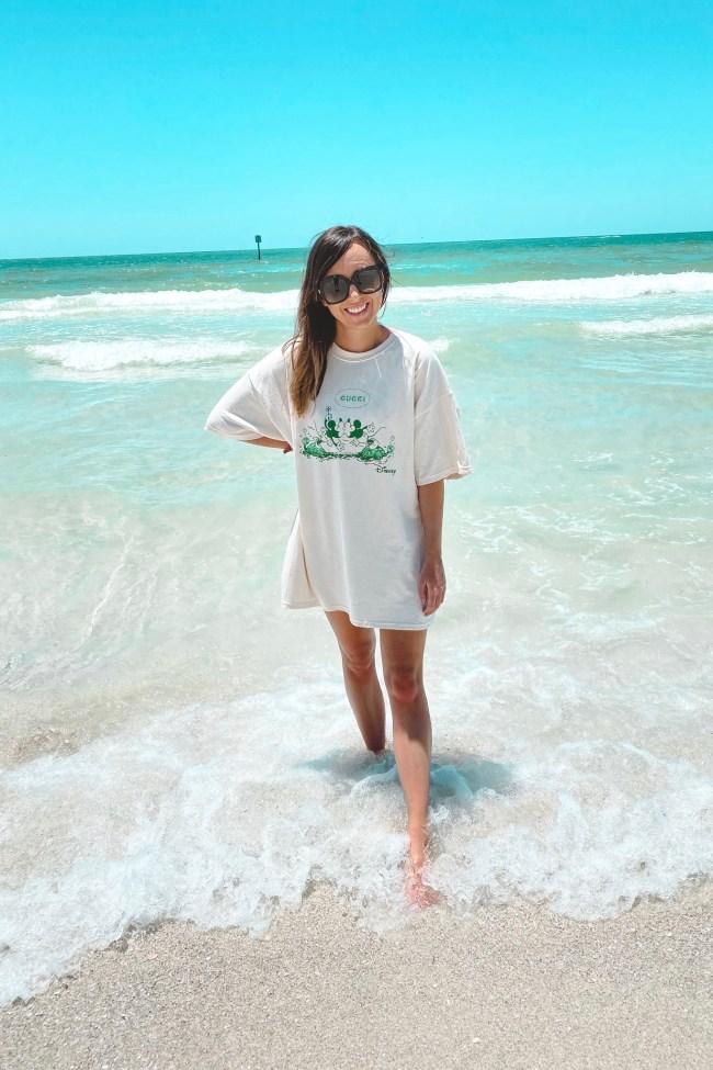 gucci disney tshirt dress at beach