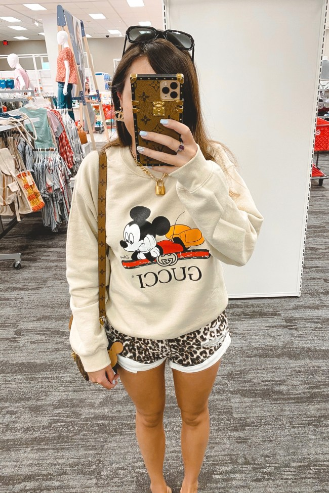 gucci disney cream sweatshirt with leopard shorts and louis vuitton lock necklace