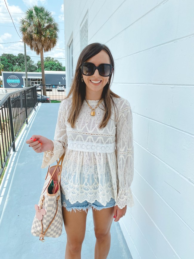 chicwish white lace blouse with agole denim shorts and louis vuitton neverfull