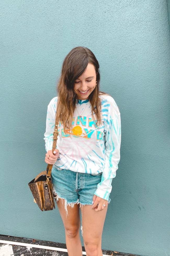 daydreamer pink floyd tie dye shirt with agolde shorts and louis vuitton pochette metis