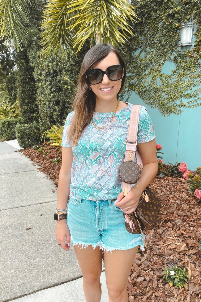 colorful snakeskin tee with agolde denim shorts and louis vuitton multi pochette