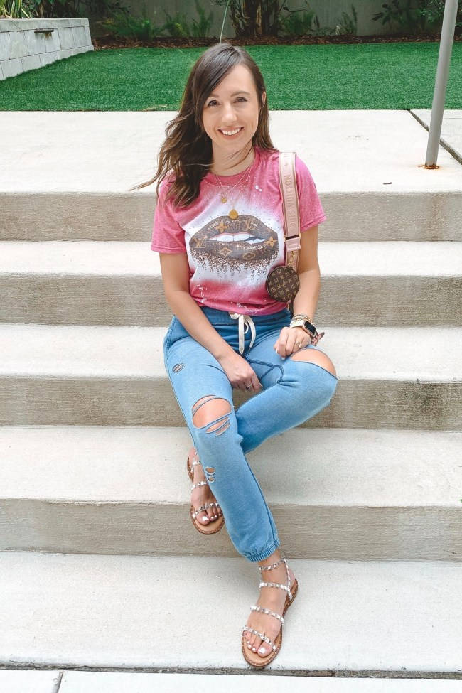 louis vuitton lips tee with ripped joggers and steve madden travel sandals