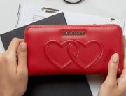 http://www.asos.com/love-moschino/love-moschino-double-heart-purse/prd/7632483?iid