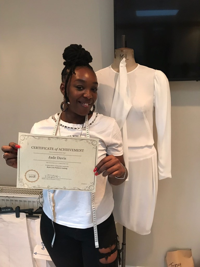 student with certificate in pattern cutting