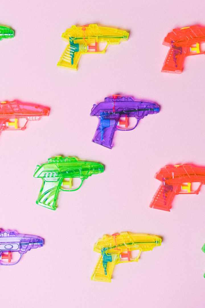 assortment of colorful plastic guns for pretend fight
