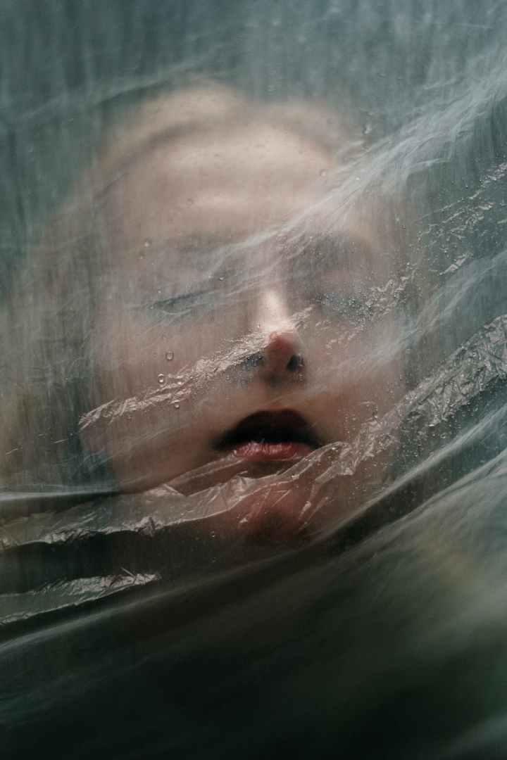 woman behind a plastic bag