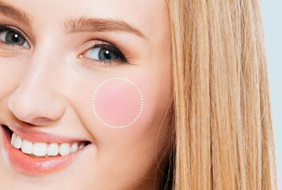 Apply blush on cheek apples