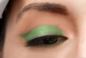 Dab green shadoe in the base of lower eye