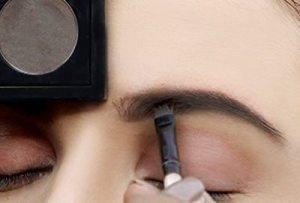 Fill eyebrows with eyeshadow brow shadow