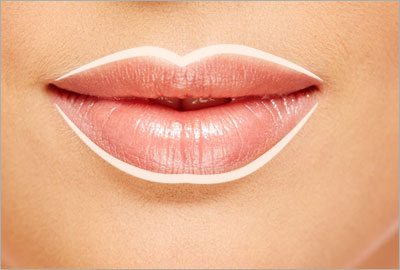 Fake an artificial lip line by using a concealer