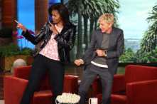 Michelle Obama with Ellen DeGeneres.The dancing TV host showed the first lady some moves and it looks like Michelle can swing her hips with the best of them. PHOTO: Michael Rozman/WB