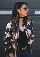 topshop camo bomber jacket with black body suit, choker and chanel boy bag