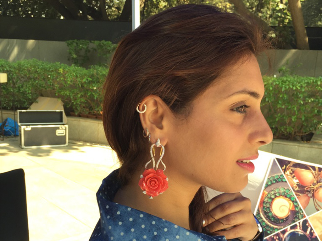 Jewelry - Designs by Avani Sayed. Floral powder Coral Earrings with white diamonds. PC: Style Prer.