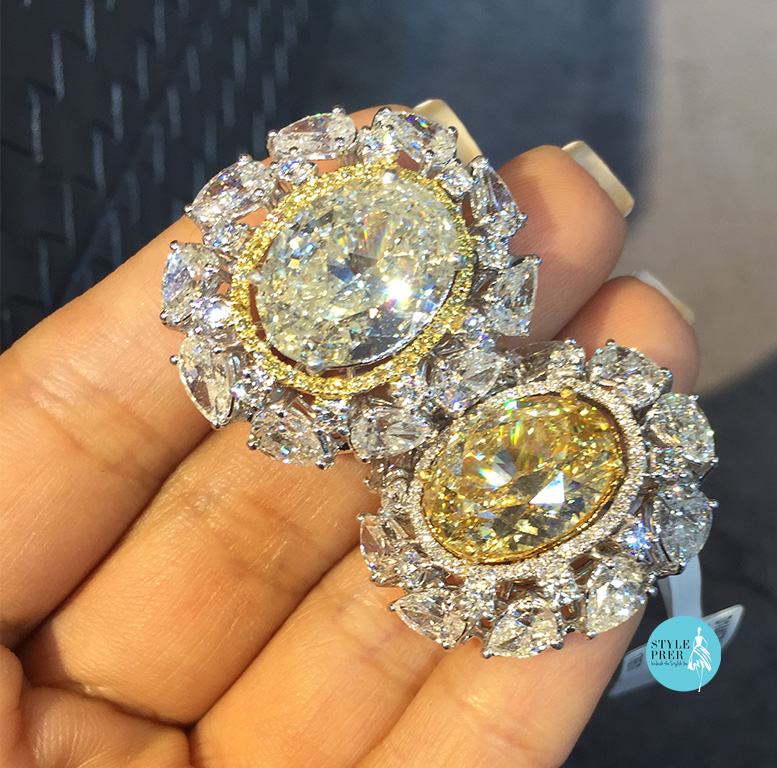Oval Yellow Diamonds Swanked With Pear And Round Diamonds On The Side- Mehta & Sons.