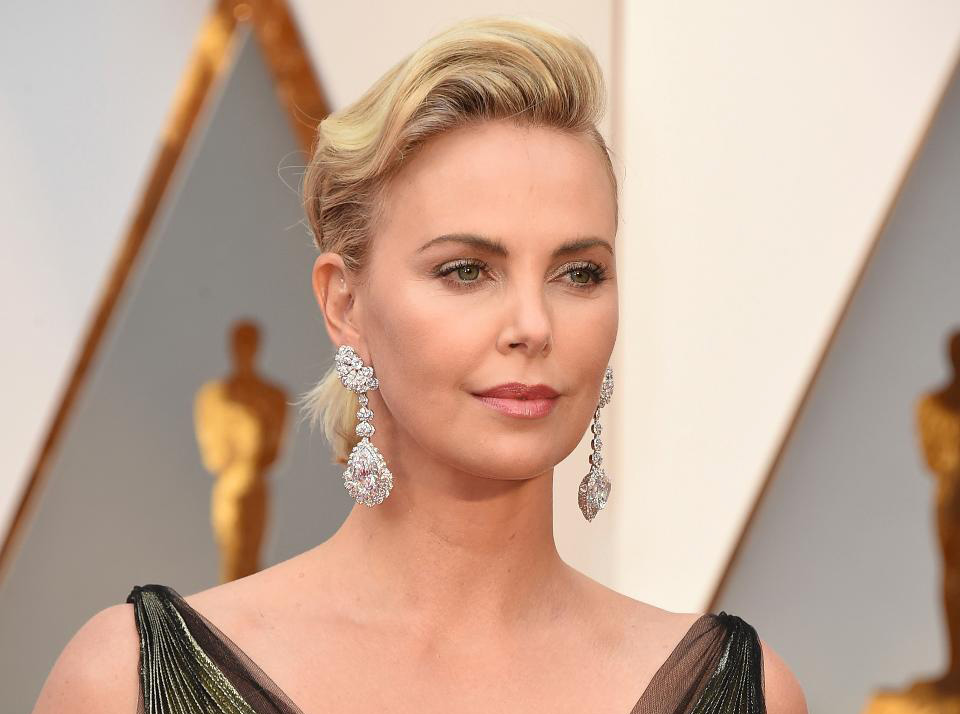 "Charlize Theron wore a pair of statement earrings by Chopard featuring a 25-carat pear-shaped D-flawless diamond and 26-carat heart-shaped D-flawless diamond, 4.55-carats of pear-shaped diamonds and 4.35-carats of brilliant-cut diamonds set in 18k white 'Fairmined' gold from the ""Garden of Kalahari Collection."" If you can remove your eyes from the earrings she also wore a ring with a 7.11-carat pear-shaped diamond and 1.14-carat of diamonds set in 18k white gold, and a diamond ring featuring a 4.04-carat diamond set in 18k white gold, both from the ""High Jewelry Collection."" PC- Forbes"
