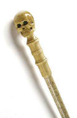 19th-century whalebone walking stick with skull pommel in ivory with green glass eyes, once owned by Charles Darwin.