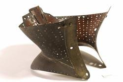 A 19th-century brass corset used to minimise the waist or as an orthopedic device to support the back or correct a spinal deformity. Probably English.