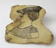 A tattoo on a piece of human skin showing a male bust and a flower stem. Late 19th century.