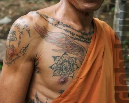 Buddhist Mantras Tattoo On Chest