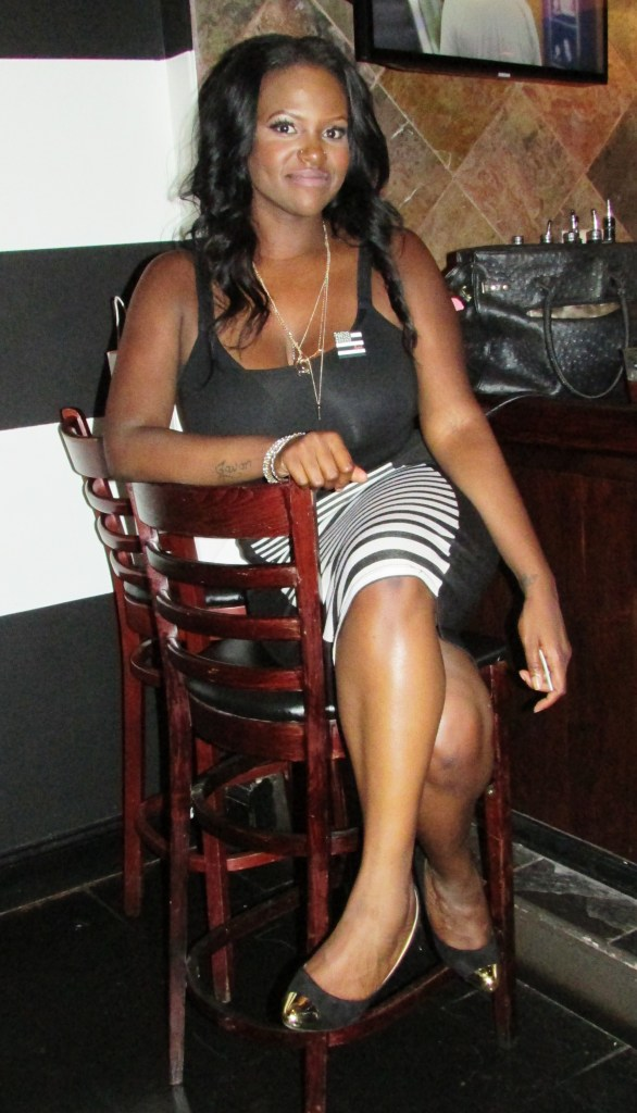 Ms. Alicia Imani in the house..check her out! Love the striped skirt!
