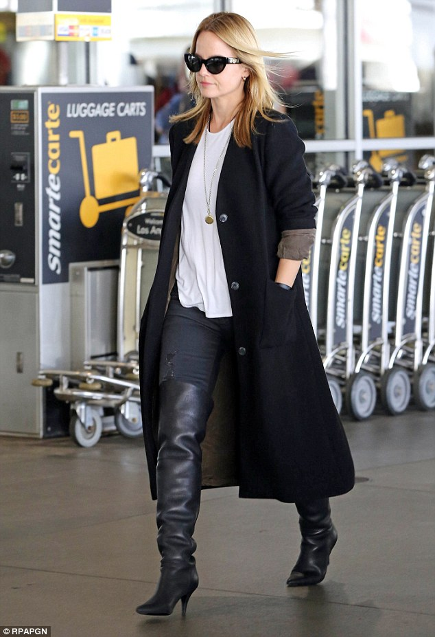 Mena Suvari paired her OTK's with denim, basic tee, and a long coat