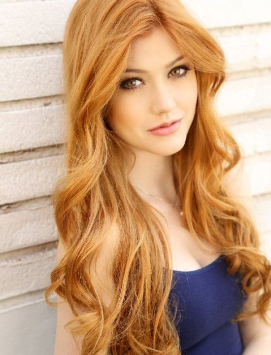 long and curly strawberry blond hair