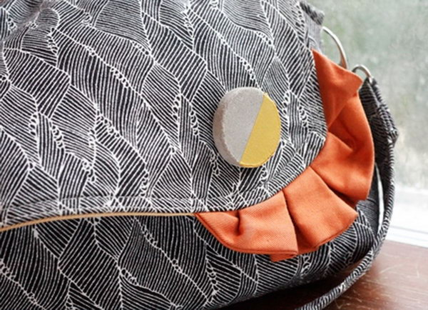 2 diy cement brooches on handbag - 20 Cool DIY Concrete Project Ideas