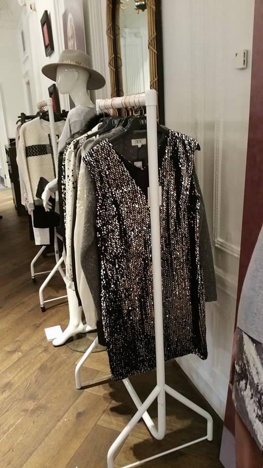 Glitzy rails of clothing.
