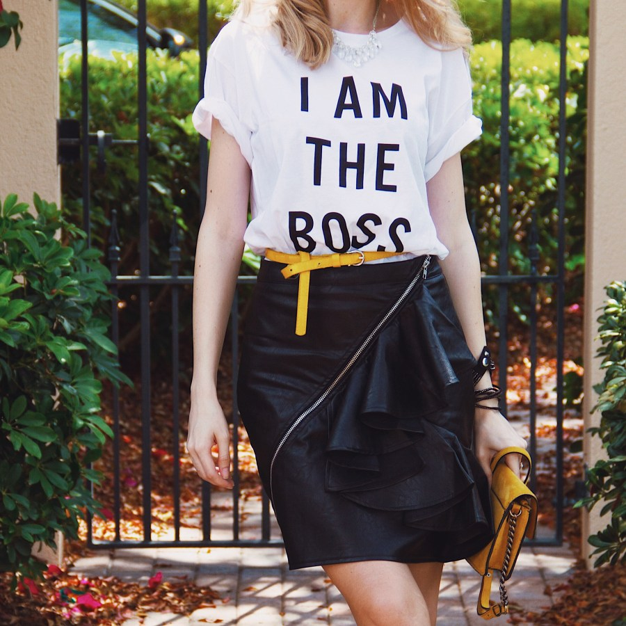 I am the Boss Graphic Tshirt Black leather ruffle skirt mustard bag white Lacoste sneakers