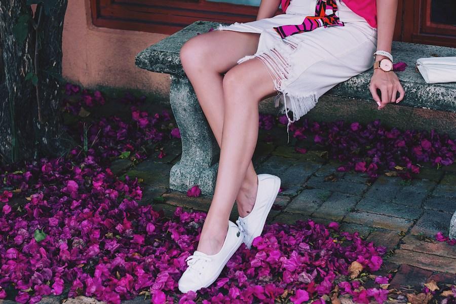 White distressed denim midi skirt and white sneakers