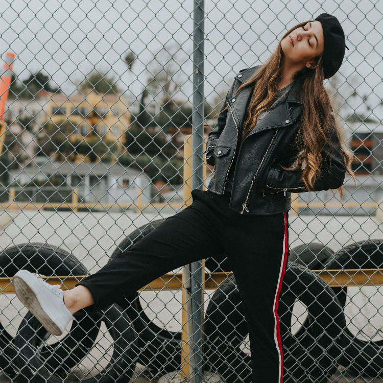 leather jacket jogger pants white sneakers fashion hat