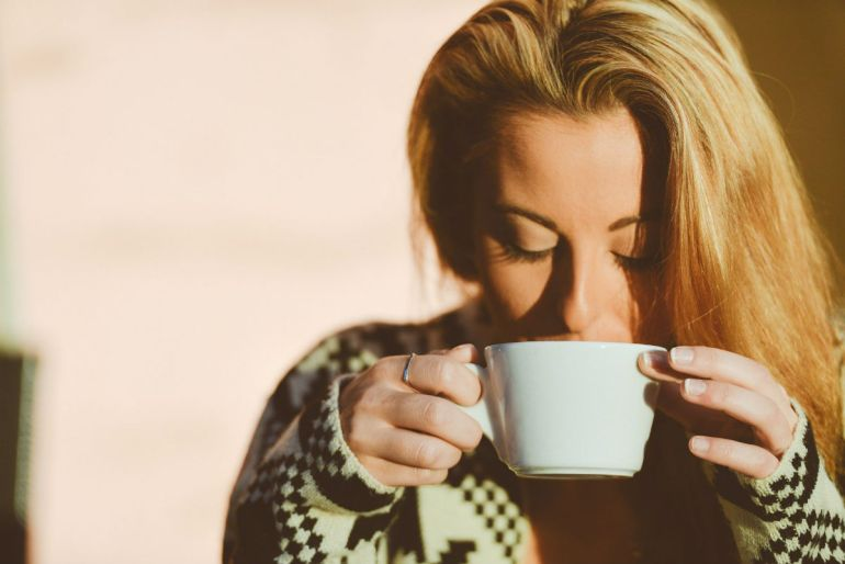 woman drinking coffee tea
