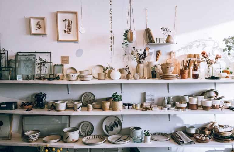 assorted ceramics on wooden shelves