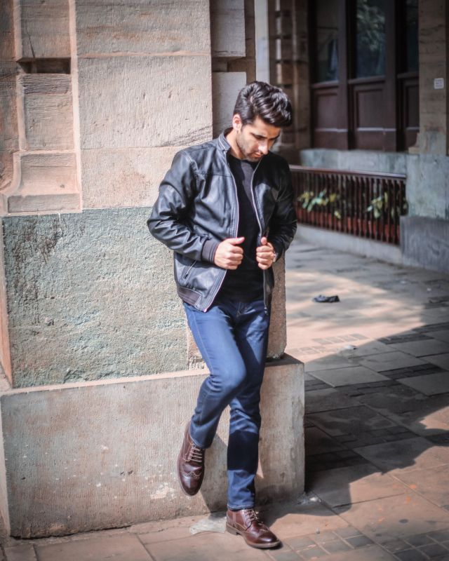 Black leather Jacket paired with Dark Brown Boots - Street Style